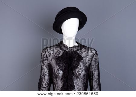 Portrait Of Mannequin With Black Lace Blouse And Hat. Dark Grey Isolated Background.