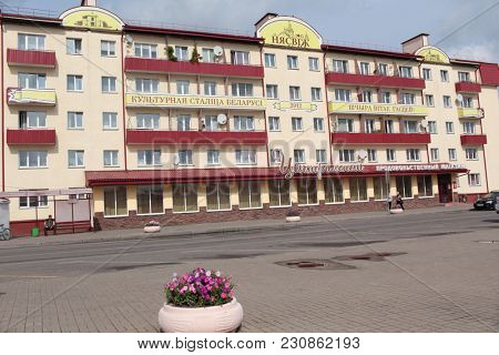 NESVIZH, BELARUS - AUGUST 27, 2012: People at the Central Food Store on Sovetskaya street. The town is known for the Nesvizh castle listed as UNESCO World Heritage