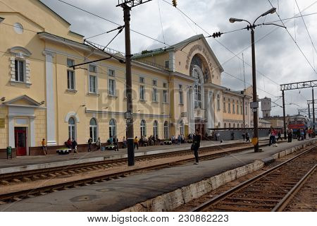 BARANOVICHI, BELARUS - AUGUST 27, 2012: People on the train station Baranovichi Polesskie. The station created in 1884, stone building was erected in 1899, destroyed during WWII and reconstructed