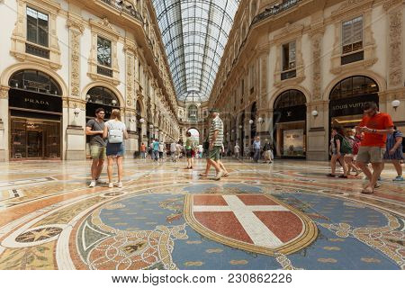 MILAN, ITALY - JUNE 12, 2017: People in the Galleria Vittorio Emanuele II. Built by Giuseppe Mengoni in 1865-1877, it is one of the world oldest shopping malls