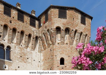 GRADARA, ITALY - JUNE 16, 2017: One of towers of Gradara castle. The Gradara Castle dates back to the period between 11th and 15th centuries