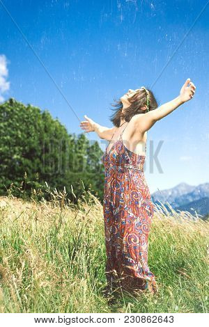 Girl Meditates Alone In A Hillside Meadow.