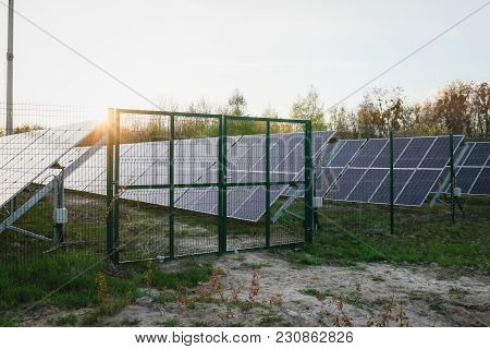 Solar Panel On Sky Background.behind The Fence