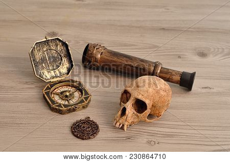 A Compass, Eyeglass And A Pirate Coin For A Pirate Game With A Monkey Skull