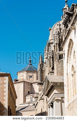 Low Angle View Of Lateral Facade Of Cathedral Of Toledo With San Marcos Church On Background