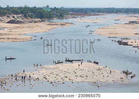 Dawki, India - May 15, 2017: Indian tourists riding boats on Umngot river near the Dawki village, Meghalaya, North East India