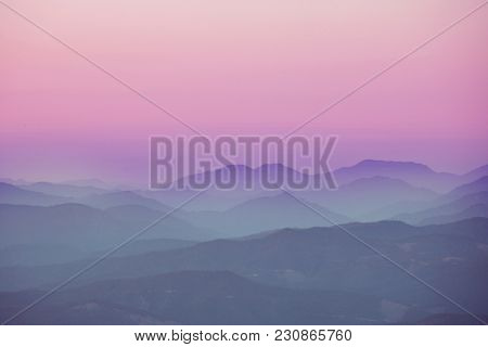 Mountain silhouette at sunrise