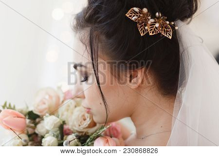 Back View Of Young Brunette Bride With Barrette In Hair. Flower Bouquet On Background. Close-up Faci