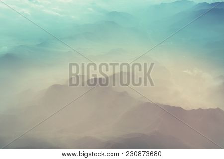 Fantastic Mountain silhouette in cloudy weather