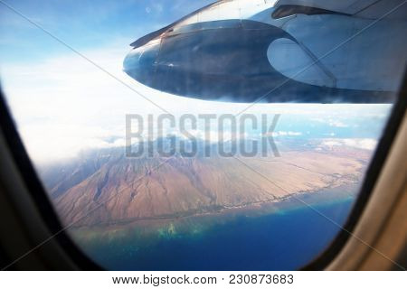 Aerial view from aircraft flying in high altitude. Landscape from above.