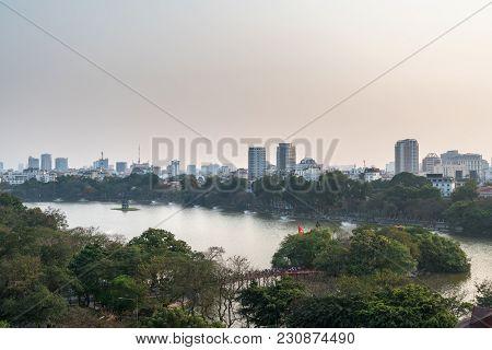 Aerial Skyline View Of Hoan Kiem Lake Or Ho Guom, Sword Lake Area At Twilight. Hoan Kiem Is Center O