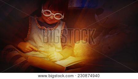 Cute Little Child Girl Reading A Magic Book With Teddy Bear Before Bedtime (sleep, Health, Childhood