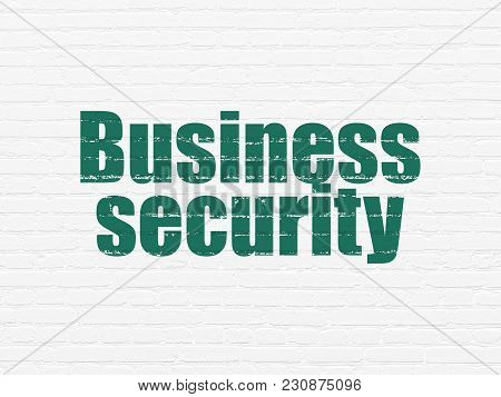 Safety Concept: Painted Green Text Business Security On White Brick Wall Background