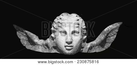 Angel Of Death As A Symbol Of The End Of Life. Ancient Statue On Black Background. (religion, Eterna