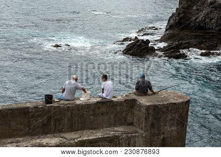 Porto Da Cruz, Madeira, Portugal - September 11, 2016: Fishing Only For The Brave On The Breakwater