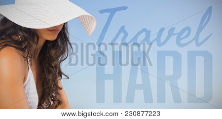 Travel hard against sexy young woman applying sun cream