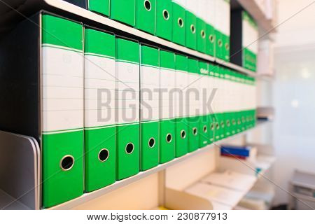 Folders With Documents On Office Shelves