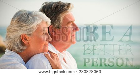 Woman hugging her husband at the beach against be a better person