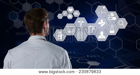 Rear view of male doctor standing against white background against digital background with chemical data and emergency sign