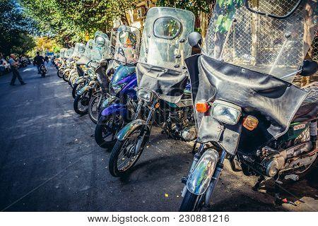 Tehran, Iran - October 15, 2016: 125 Cc Bikes Parked On A Sidewalk In Tehran