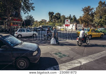 Tehran, Iran - October 15, 2016: Cars, Bikes And Pedestrians On A Large Crossroads In Tehran