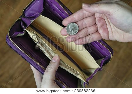 Empty Wallet And A Hand With A Quarter Dollar