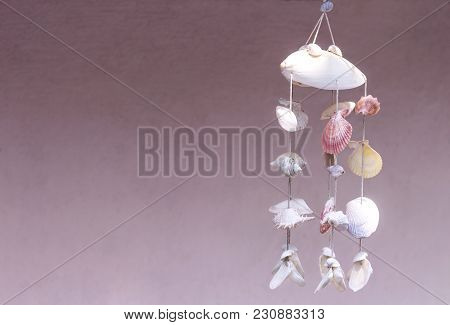 Seashells Hanging On Pink Background. Seashell Mobile Is Handicrafts Produced By Handmade. With Copy