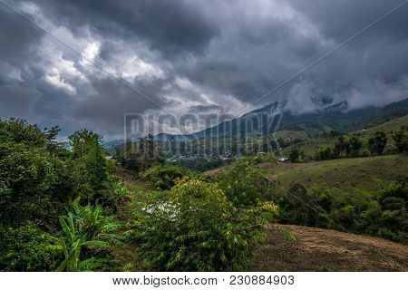 Village In The Hill Of Forest Mountain With Cloudy Sky Behind, Traveling In Thailand