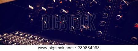Close-up of sound recording equipment in recording studio