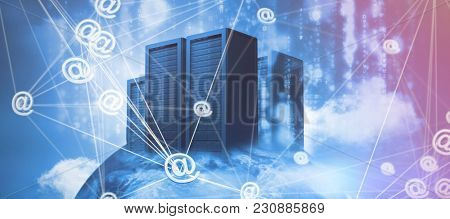 Abstract image of at email sign against server racks against sky and cloud