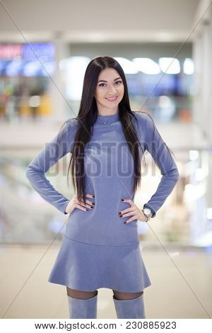 Portrait of beautiful happy stylish woman in dress and trendy shoes, walking in city shopping center. Fashion woman lifestyle. Woman style, trendy outfit.