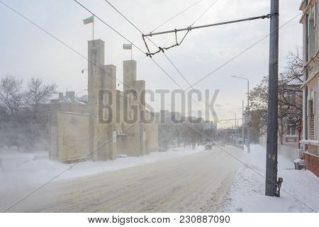 Varna, Bulgaria, February 28, 2018: 8Th Infantry Regiment Memorial Gate Under The Snow Storm.the Mon