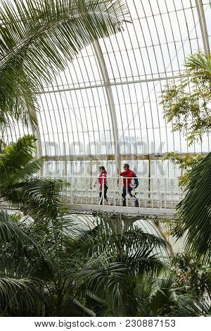 London, Uk - April 18, 2014. Visitors Walk Around The Interior Of The Palm House At Kew Gardens. The