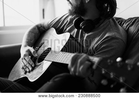 Caucasian man in a songwriting process music concept