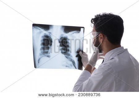 Young doctor looking at x-ray images isolated on white