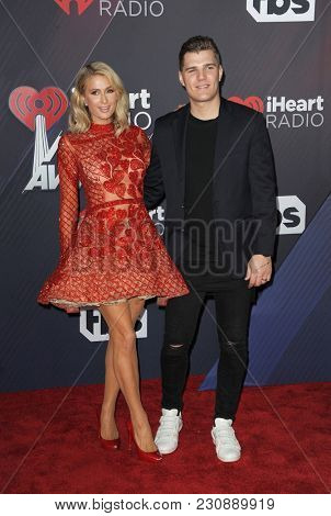 Chris Zylka and Paris Hilton at the 2018 iHeartRadio Music Awards held at the Forum in Inglewood, USA on March 11, 2018.