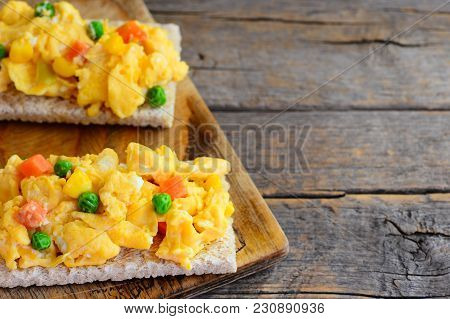Delicious Scrambled Eggs With Peas And Carrots On Crispy Toast. Scrambled Eggs Omelette Toast Recipe