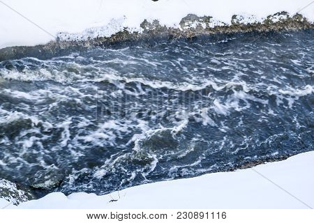 Stormy Creek. Wave And Foam In The Flow. Splashes, Bubbles, Waves, Stream, Ripples And Crests Of Wav