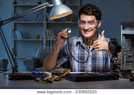 Computer repair concept with man inspecting with stethoscope