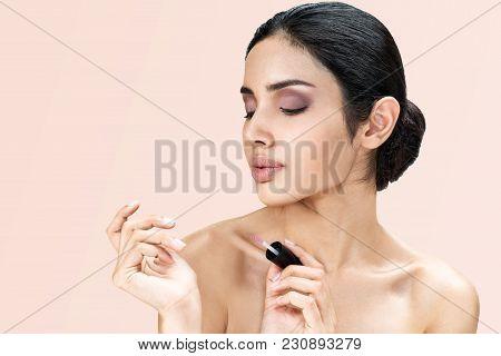 Young Asian Beautiful Woman Face Portrait Natural Make-up Applying Transparent Nail Or Painting Nail