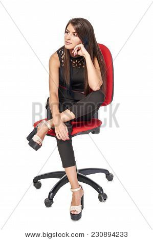 Thinking Woman In Black Sitting On Office Chair Leaning On Elbow Looking To The Side, Full Length Po