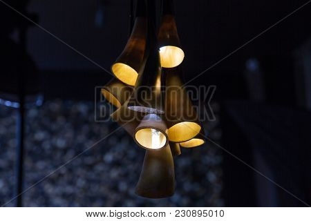 Chandelier From Cow Horns In The Interior. Dark Background