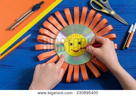 Child Makes Smiling Sun From Cd. Step 9