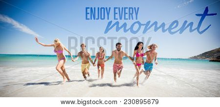 Enjoy every moment against friends having fun at the beach Friends having fun at the beach on a sunny day