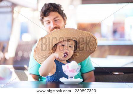 Father Feeding Llittle Girl With Ice Cream, Indoors. Family Lifestyle.