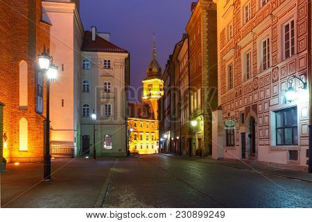 Royal Castle And Beautiful Street In Old Town During Evening Blue Hour, Warsaw, Poland.