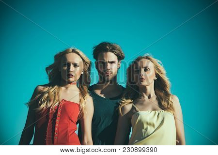 Man With Beard With Twins, Relations. Twins Women With Macho On Blue Sky Background. Love Triangle A