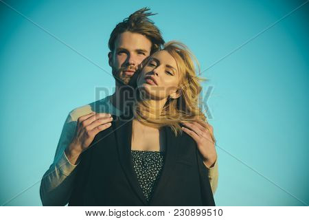 Relations Of Happy Family, Future. Couple In Love On Blue Sky Background. Muscular Man And Woman Wit