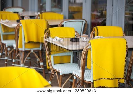 Restaurant Zone With Colorful Plastic Chairs And Tables And Yellow Plaid In The Lobby Of The Mall. B