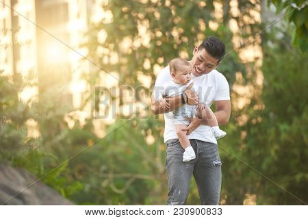 Happy Young Father Walking With His Little Kid